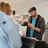 Alan Kelleher, owner of North Shore Vapors, on Highland Ave in Salem, demonstrates how to change and refill the liquid used in an e-cigarette for a customer on Monday afternoon. There has been recent talk that the FDA would mandate warning labels on the liquid refill bottles, however Kelleher says it could take up to two-years to pass. DAVID LE/Staff photo. 4/28/14
