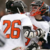 Beverly senior midfielder Nick Donovan (26) celebrates his 4th quarter goal with freshman midfielder Sam Abate (5) against Hamilton-Wenham on Friday afternoon. DAVID LE/Staff photo 4/4/14