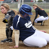 Beverly catcher Cori Coults, left, can't manage to swipe the tag onto Malden's Jill Powers, right, as she slides safely into home on a close play at the plate on Thursday afternoon. DAVID LE/Staff photo. 4/17/14