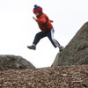 KEN YUSZKUS/Staff photo.  Luke Marino, 5 1/2, of Beverly, jumps from rock to rock on his way to a gymnastics class at the Greater Beverly YMCA Sterling Center Thursday afternoon. 4/17/14