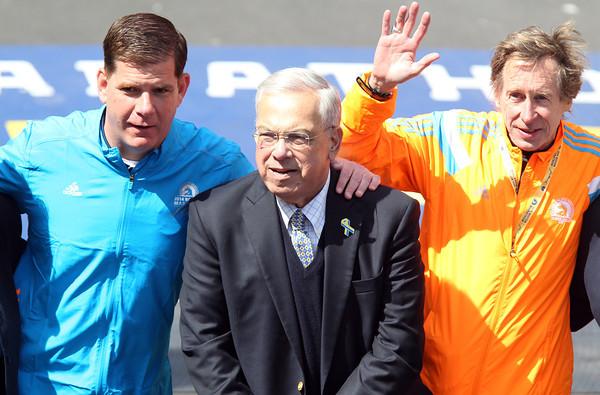 Current Boston Mayor Marty Walsh, former Boston Mayor Tom Menino, and three-time Boston Marathon winner Bill Rodgers, pose for a photo near the finish line of the 118th Boston Marathon. DAVID LE/Staff photo 4/21/14