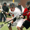 Beverly freshman midfielder Sam Abate (5) shields the ball from the stick check of Marblehead defense Alex Conn, right, during the second quarter of play on Tuesday afternoon. DAVID LE/Staff photo 4/15/14