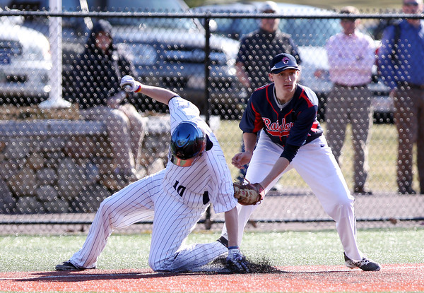 St. John's Prep junior Nick Latham (10) slides safely into third base ahead of the tag from Central Catholic's Evan Becht. The Eagles cruised to a 9-3 win over the Raiders at St. John's Prep in Danvers on Thursday afternoon. DAVID LE/Staff photo 4/10/14