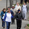 KEN YUSZKUS/Staff photo. In front, Janice Pierce, left, of Beverly, and Elyse Carroll of Peabody are in the lead of a group of walkers participating in the Good Friday Walk on Corning Street in Beverly.