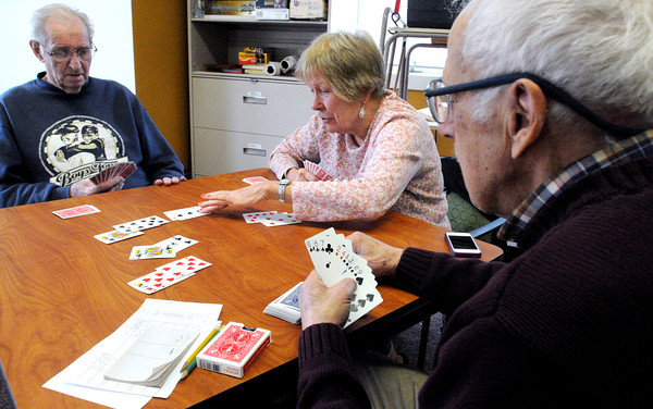 KEN YUSZKUS/Staff photo. From left, Gordon Estes, Mary Jane Gugler, and Rafaele Lauranzano, all of Beverly, play bridge during the contract bridge activity Tuesday afternoon at the Council On Aging Senior Community Center in Beverly. The contract bridge activity is held Tuesday afternoon at 12:30 - 3:30 and they are always looking for new players.