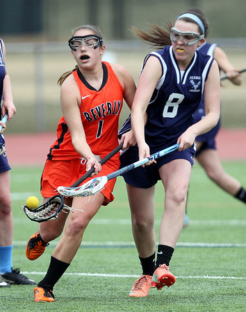 Beverly's Marita Smallman (1) battles for a loose ball with Peabody's Sydney Cooke (8) on Friday afternoon. DAVID LE/Staff photo. 4/11/14