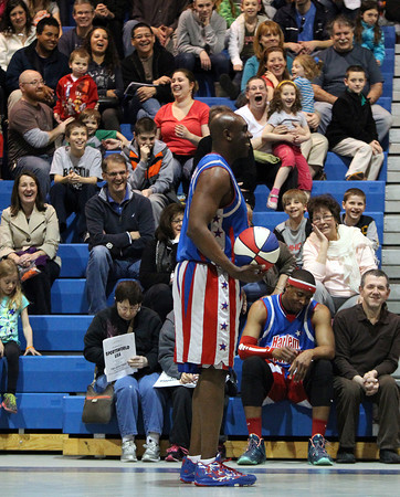 Harlem Superstars player Show Boat entertains a large crown inside the gymnasium at Peabody High School as the Harlem Superstars took on the Peabody Firefighters team. DAVID LE/Staff photo. 4/19/14