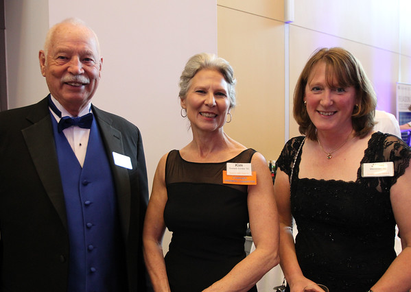 """From left: Dick Gassett, Kim Gassett-Schiller, and Janet Merriman, at a gala held in the atrium of the Gassett Fitness Center on Saturday evening. The university announced the public phase of a $25 million campaign, the largest fundraising initiative ever taken by the university, and announced that they've already raised $15 million towards the goal in a private phase of the campaign, which they called """"10,000 reasons."""" DAVID LE/Staff photo. 4/12/14"""