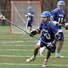 KEN YUSZKUS/Staff photo.  Danvers Anthony Serino brings the ball up field during the Danvers at Marblehead boys lacrosse game. 4/23/14