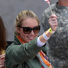 A young woman waves an American flag while watching the finish of the 118th Boston Marathon on Monday morning. DAVID LE/Staff photo 4/21/14
