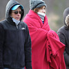 Kathy Pitman and Cheryl Cabral bundled up in winter clothes and a blanket as they watched the Beverly High School softball game at Innocenti Park in Beverly on Thursday afternoon. DAVID LE/Staff photo. 4/17/14