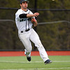 Endicott sophomore third baseman Matthew Paola (18) makes an off balance throw to first base to try and cut down a Salem State runner. DAVID LE/Staff photo. 4/23/14