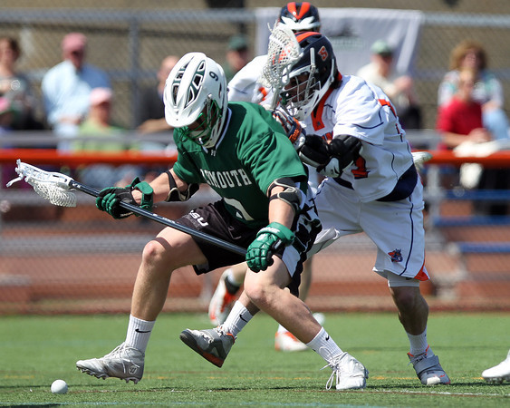 Salem State freshman midfielder Austin Duhaime (7) battles with Plymouth State freshman defense Tyler Hawley (9) for a loose ball in front of the Panthers net on Saturday afternoon. DAVID LE/Staff photo. 4/12/14