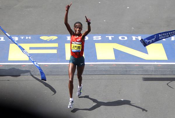 Rita Jeptoo, the Women's Elite winner of the 118th Boston Marathon crosses the finish line to repeat as the winner of the marathon. DAVID LE/Staff photo 4/21/14