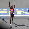 Rita Jeptoo, the Women's Elite winner of the 118th Boston Marathon crosses the finish line to repeat as the winner of the marathon. DAVID LE/Staff photo 4/21/14