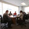 KEN YUSZKUS/Staff photo.   Wolfgang Koch, left, speaks to members of the Job Club, from left, Douglas Brewer, Joseph Anderson, James Friendley, and Syretta Copeland.    04/16/15
