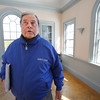 KEN YUSZKUS/Staff photo.  George Saluto looks over the inside of the Elias Hasket Derby/Samuel McIntire house in Danvers which is threatened by a family of squirrels, that are causing damage both inside and outside the structure.     04/01/15