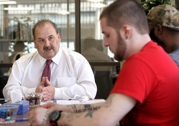 KEN YUSZKUS/Staff photo.    Paul Ventresca, left, speaks with members of the Job Club.   04/16/15