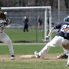 KEN YUSZKUS/Staff photo.  St. John's Prep's Jacob Yish steals 2nd base as Peabody's Ryan Collins gets the throw and Christian Morales comes in to help at the St. John's Prep vs Peabody baseball game.     04/23/15