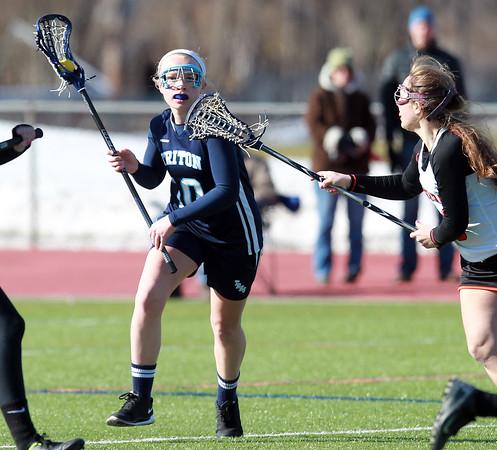 DAVID LE/Staff photo. 4/4/15. Triton attack Samantha Brown carries the ball upfield.