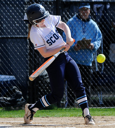 PAUL BILODEAU/Staff photo. The Fighting Scots' Megan Jenkerson hitting this ball during Gordon College's game against Lasell College in Wenham Tuesday afternoon.