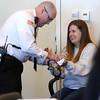 KEN YUSZKUS/Staff photo.    Kristen Labrie has her handcuffs removed at her bail hearing in Salem Superior Court.      04/14/16