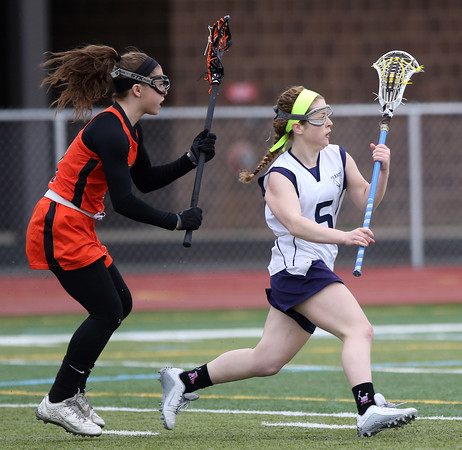 DAVID LE/Staff photo. Peabody's Lauren Wolff (5) sprints past a Beverly player during the first half of play. 4/12/16.