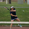 RYAN HUTTON/ Staff photo<br /> Peabody's Andeemae Sims returns the ball hard during her 1st Doubles match with partner Chrisly Biqiku against Gloucester's Katie Nugent and Heidi Franke-Otten during Monday's tennis match at Peabody High.