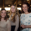 DAVID LE/Staff photo. Tori Thompson and Katerina Kerastaris, both of Peabody, and Jess Yurwitz, Principal of the New Liberty Charter School in Salem, at a fundraiser to benefit LEAP for Education at the Danversport Yacht Club on Wednesday evening. 4/13/16.