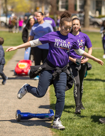 PARKER FISH/ photo.  Thirteen year old Brianna Guerrero jumps off of her hover board after crossing the finish line.   4/24/16