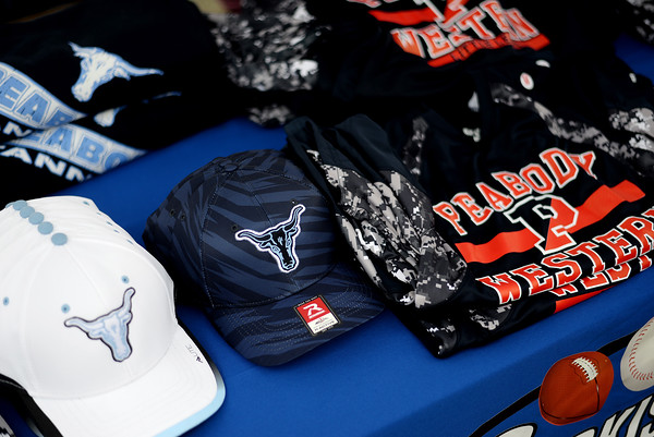 PAUL BILODEAU/Staff photo. Litte league hats and jerseys for sale during the annual Peabody Western Little League jamboree held at Cy Tenney Field in West Peabody.