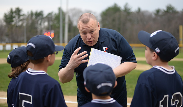 PAUL BILODEAU/Staff photo. Triple A Rays coach Steve O'Hara peps up his outfielders at the start of their game during the annual Peabody Western Little League jamboree held at Cy Tenney Field in West Peabody.