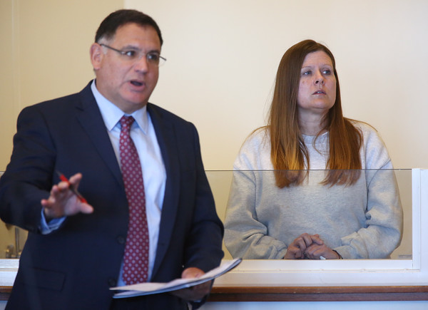 KEN YUSZKUS/Staff photo.    Kristen Labrie with her attorney John Morris at her bail hearing in Salem Superior Court.      04/14/16