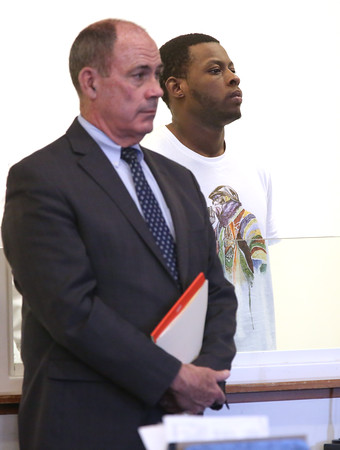 KEN YUSZKUS/Staff photo.     Jeremiah Wooden, right, stands with the defense attorney Joseph Collins in Salem District Court for his arraignment for shooting at a Salem police officer who tried to arrest him on warrants in Salem.     04/19/16