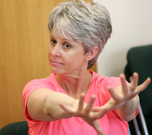 KEN YUSZKUS/Staff photo.     Laurie Grieves does some warm up exercises at the start of the Parkinson's Fitness program held at the Danvers Council on Aging. Parkinson's Fitness provides classes to those with Parkinson's Disease throughout the North Shore.    04/13/16