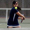 RYAN HUTTON/ Staff photo<br /> Peabody's Isabela Valencia readies her backhand as the ball approaches during her 2nd Singles match against Gloucester's Tea Ryder during Monday's tennis match at Peabody High.