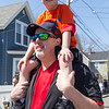 PARKER FISH/ photo. Bennie Cudmore, 5, rides on his father's shoulders as they march in the little league parade. 4/24/16