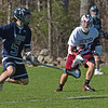 pingree Defenseman Nathan Rawlins gets some air time as he looks for an open teammate to pass to .<br /> <br /> Photo by JoeBrownPhotos.com