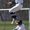 KEN YUSZKUS/Staff photo.   Danvers' Matt Andreas steals 2nd as Peabody's Jon Lawrence tries to tag him at the Danvers at Peabody baseball game.       04/18/16