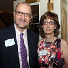DAVID LE/Staff photo. Bill Henning, Vice-President of Beverly Bank, and Linda Saris, Executive Director of LEAP, at a fundraiser to benefit LEAP for Education at the Danversport Yacht Club on Wednesday evening. 4/13/16.