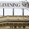 DAVID LE/Staff photo. The old Salem Evening News sign was put back atop the old news building in downtown Salem above the Adriatic Restaurant. 4/26/16.