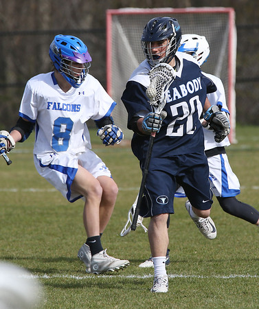 KEN YUSZKUS/Staff photo.     Peabody's Frank Falco, right, zips past Danvers' Anders Salmongen during the Peabody at Danvers boys lacrosse game.     04/28/16