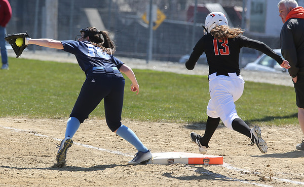 KEN YUSZKUS/Staff photo.  Peabody's Alissa Lake gets the throw to 1st and gets Beverly's Natalie Mathews out during the Peabody at Beverly softball game at Innocenti Park.     04/20/16