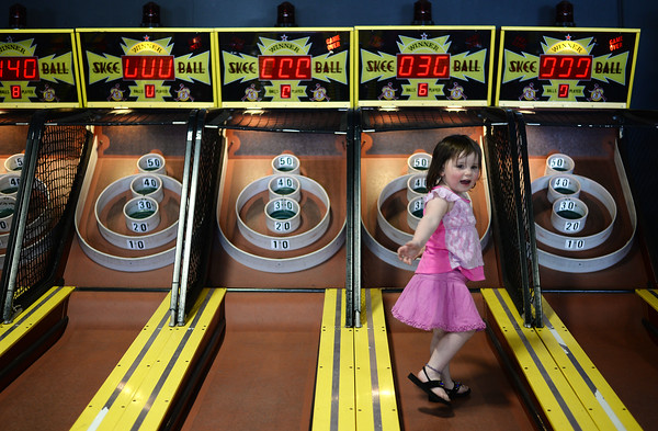PAUL BILODEAU/Staff photo. Billie Romanovitz, 3, of Beverly, gets a bit closer while playing Skee-Ball at the Salem Willows Casino, which recently opened for the year.