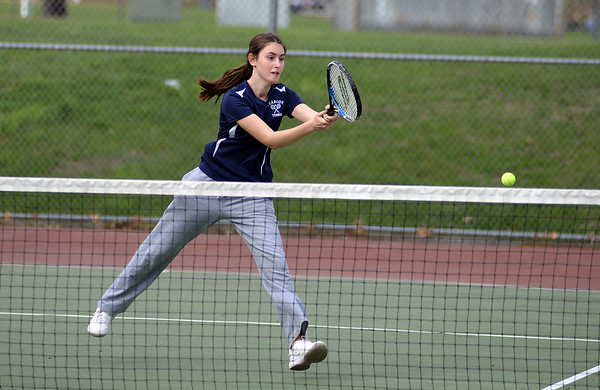 RYAN HUTTON/ Staff photo<br /> Peabody's Chrisly Biqiku follows through while returning the ball during her 1st Doubles match with partner Andeemae Sims against Gloucester's Katie Nugent and Heidi Franke-Otten during Monday's tennis match at Peabody High.