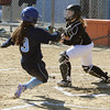 KEN YUSZKUS/Staff photo.  Peabody's Makala Iannalfo is out at home plate as Beverly's catcher Cori Coults gets the ball during the Peabody at Beverly softball game at Innocenti Park.     04/20/16