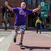 PARKER FISH/ photo. 12 year old Daniel Whitten of Salem celebrates as he runs through a crosswalk along the event route. 4/24/16
