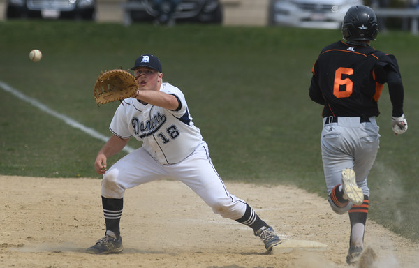 Danvers Zach Dillon awaits the ball late in the game to get Beverly Matt Collins out at first.<br /> <br /> Photo by JoeBrownPhotos.com