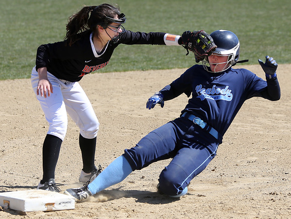 KEN YUSZKUS/Staff photo.  Peabody's Ashley Jenkins is out at 3rd as Beverly's Natalie Stilwell makes the tag during the Peabody at Beverly softball game at Innocenti Park.     04/20/16