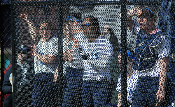PAUL BILODEAU/Staff photo. The Fighting Scots cheer on their teammates during Gordon College's game against Lasell College in Wenham Tuesday afternoon.